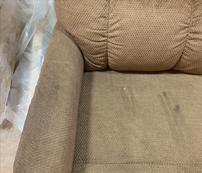 Recliner with smoke marks on it