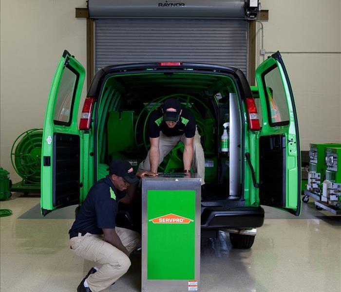 SERVPRO Vehicle with Workers unloading equipment