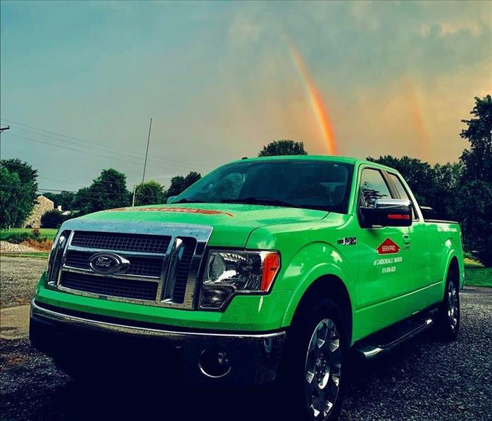SERVPRO Truck with Rainbow in the Sky Behind The Truck