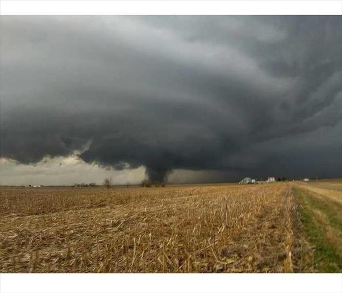 Huge storm cloud over a field