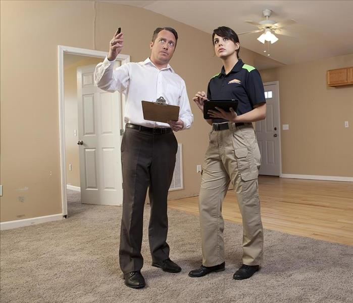 A guy and SERVPRO girl having a conversation